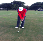 Shot of chipping when making contact with golf ball